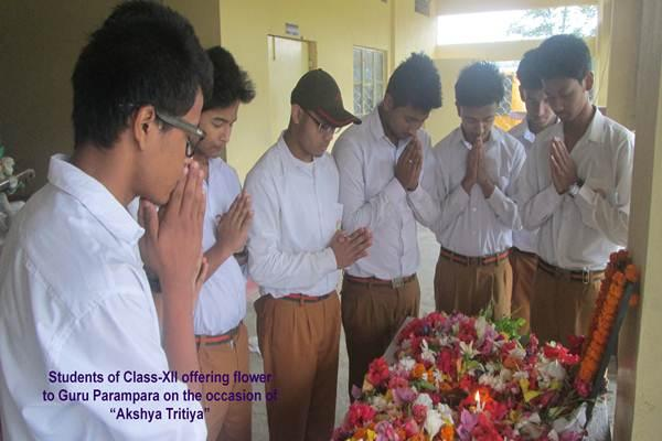 Students Of Class-XII Offering Flower To Guru Parampara On The Occasion Of